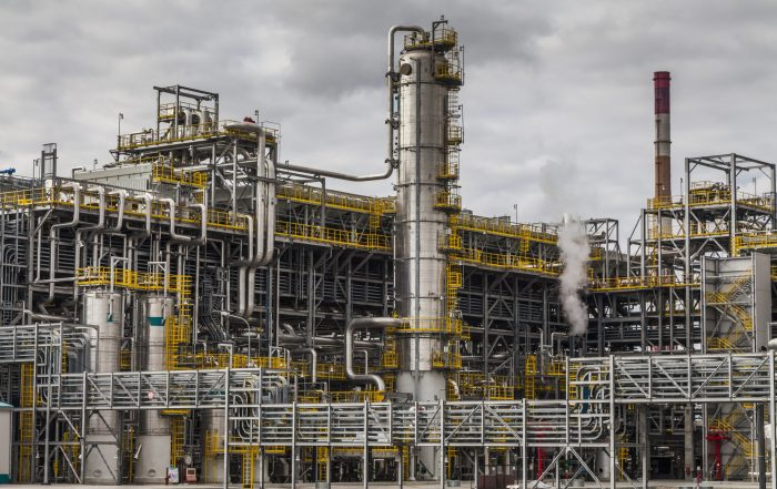 oil refinery factory at cloudy sky