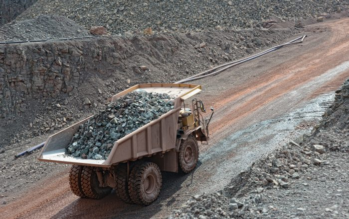 dumper truck with loaded stones driving along in a quarry. minin
