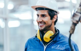 Portrait of smiling male factory worker at construction industry
