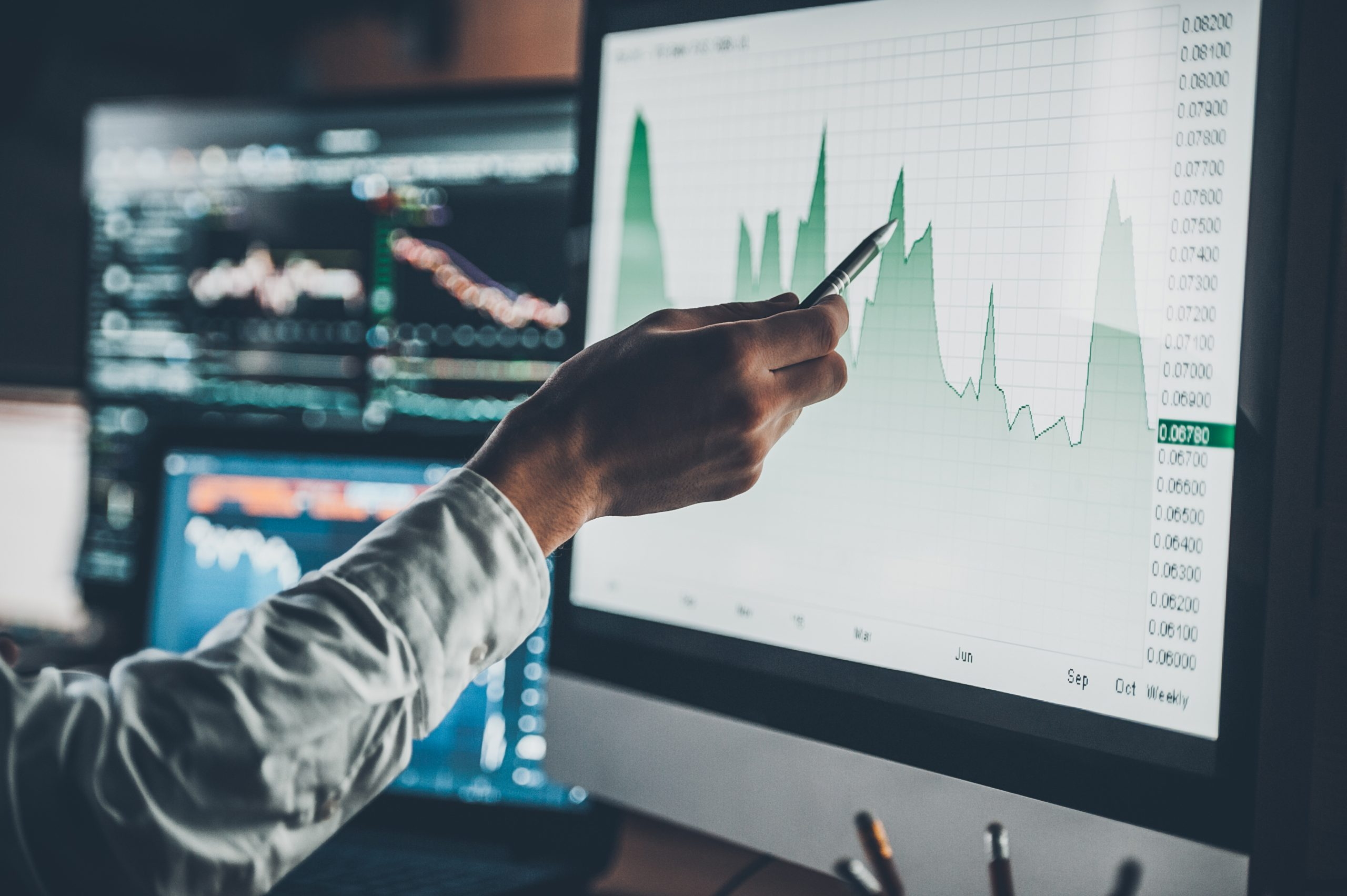 woman analyzing data on desktop