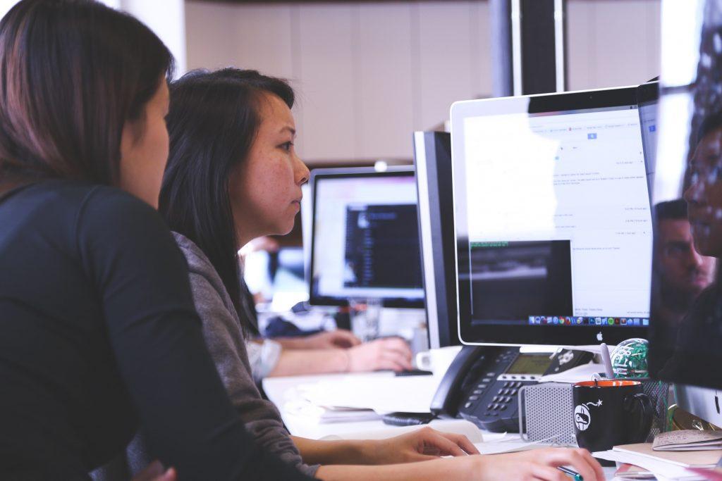 woman on desktop analyzing digital transformation information